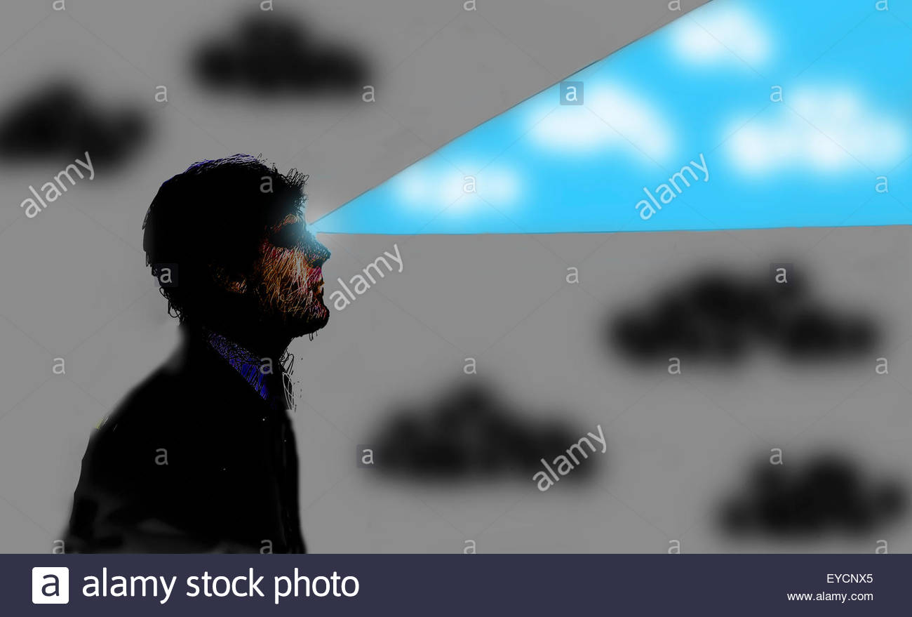 Businessman looking ahead with beam of blue sky - Stock Image