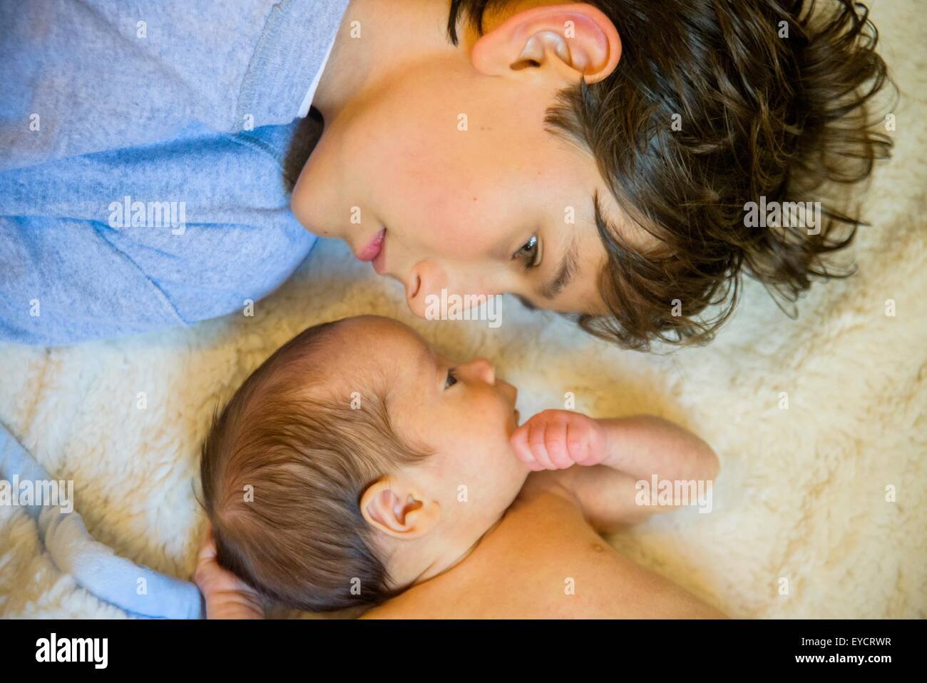 Big brother with baby brother - Stock Image