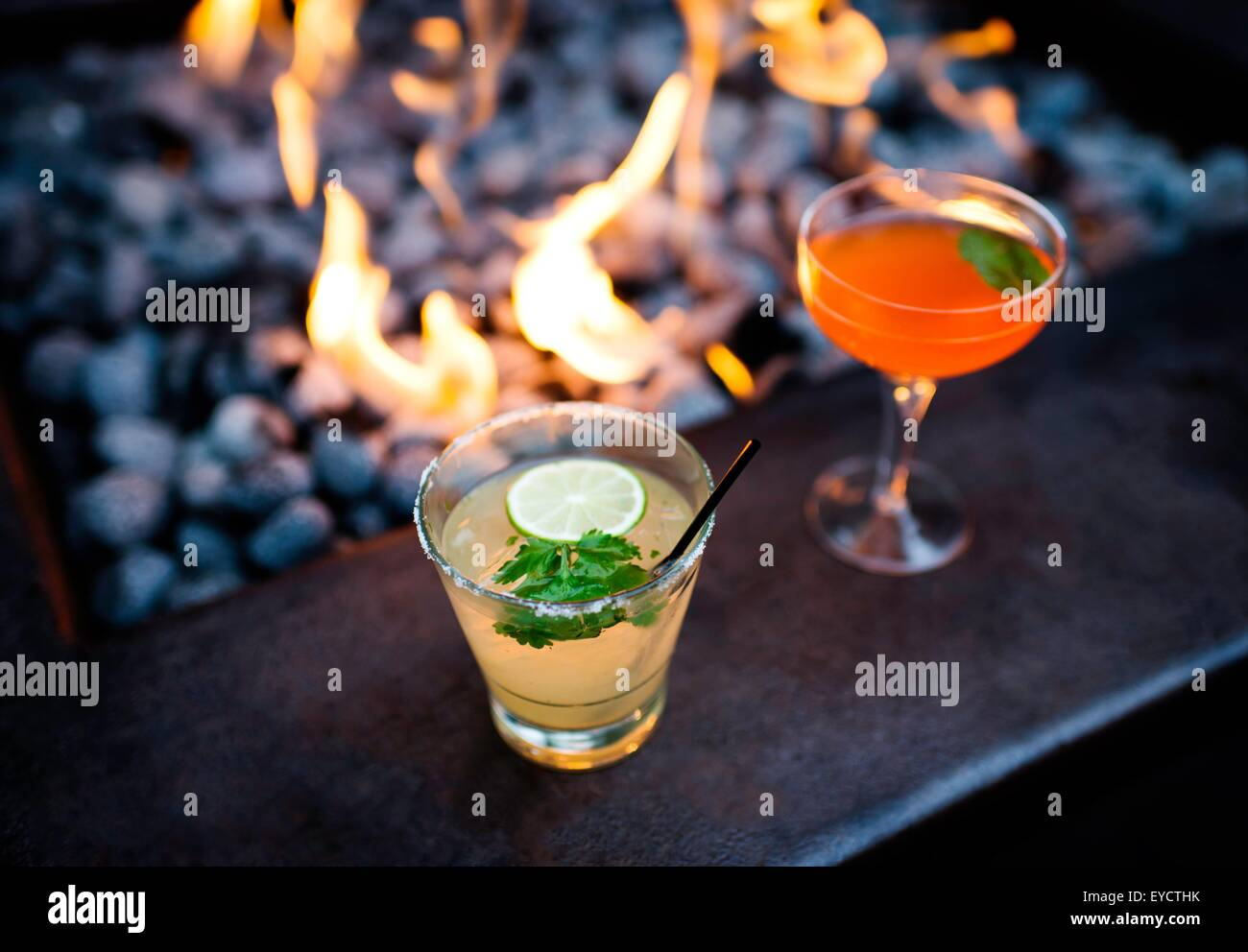 Two cocktails by restaurant open fire - Stock Image