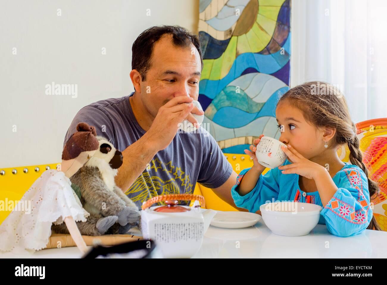 Mature man, and daughter sharing tea - Stock Image