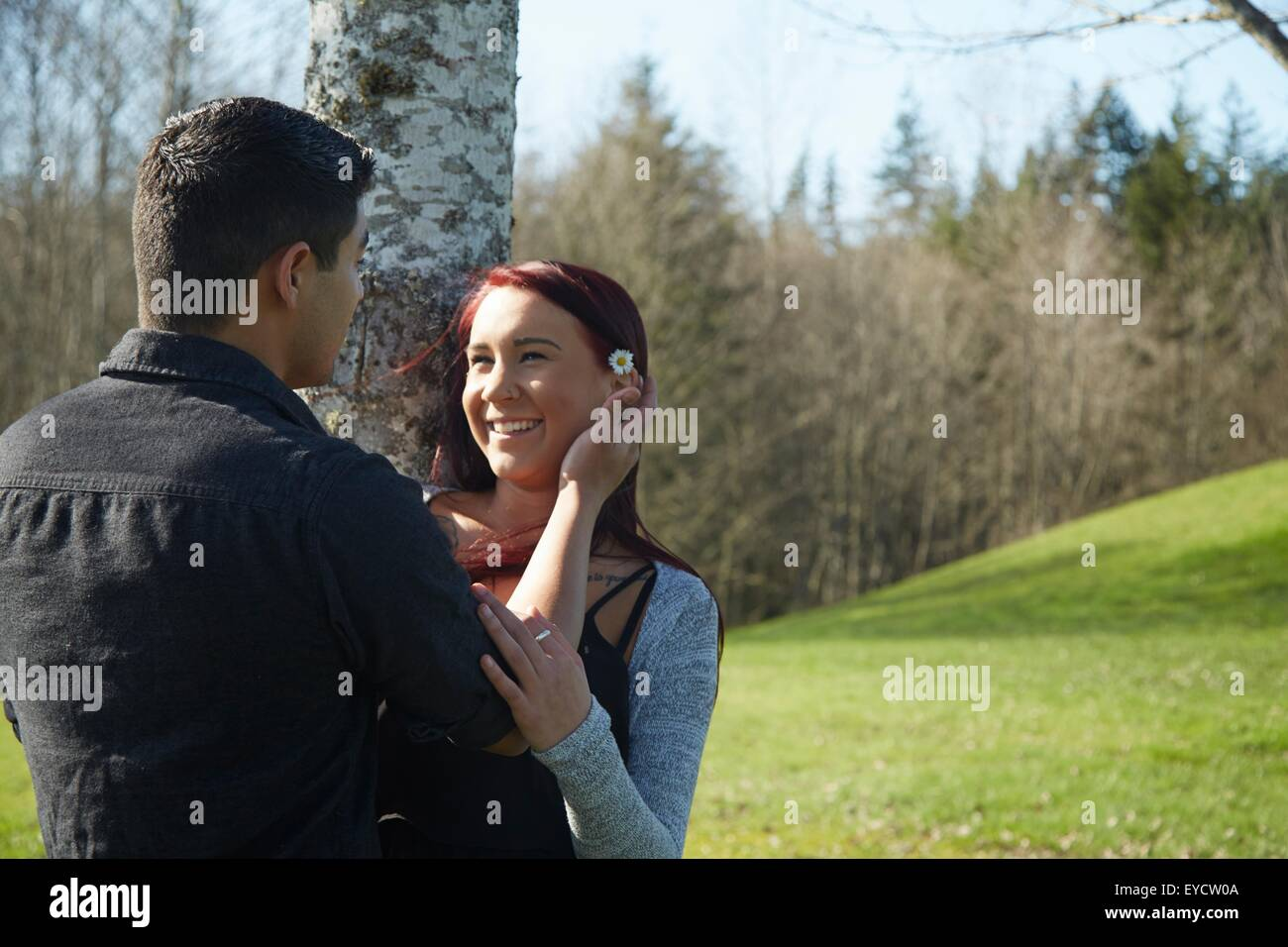 Romantic young couple in park Stock Photo