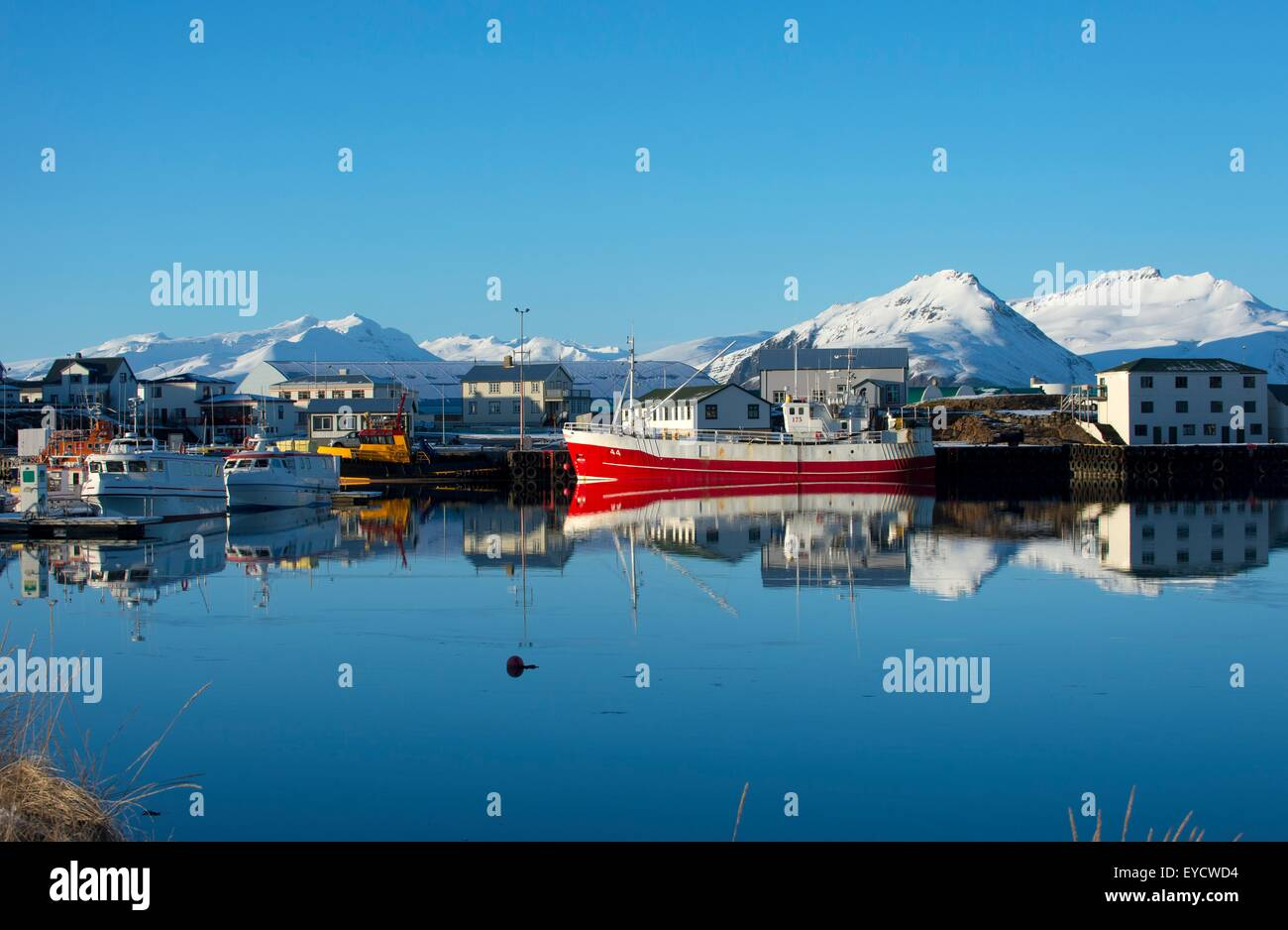 View of fishing boats and snow covered mountains, Hofn harbor, Iceland Stock Photo