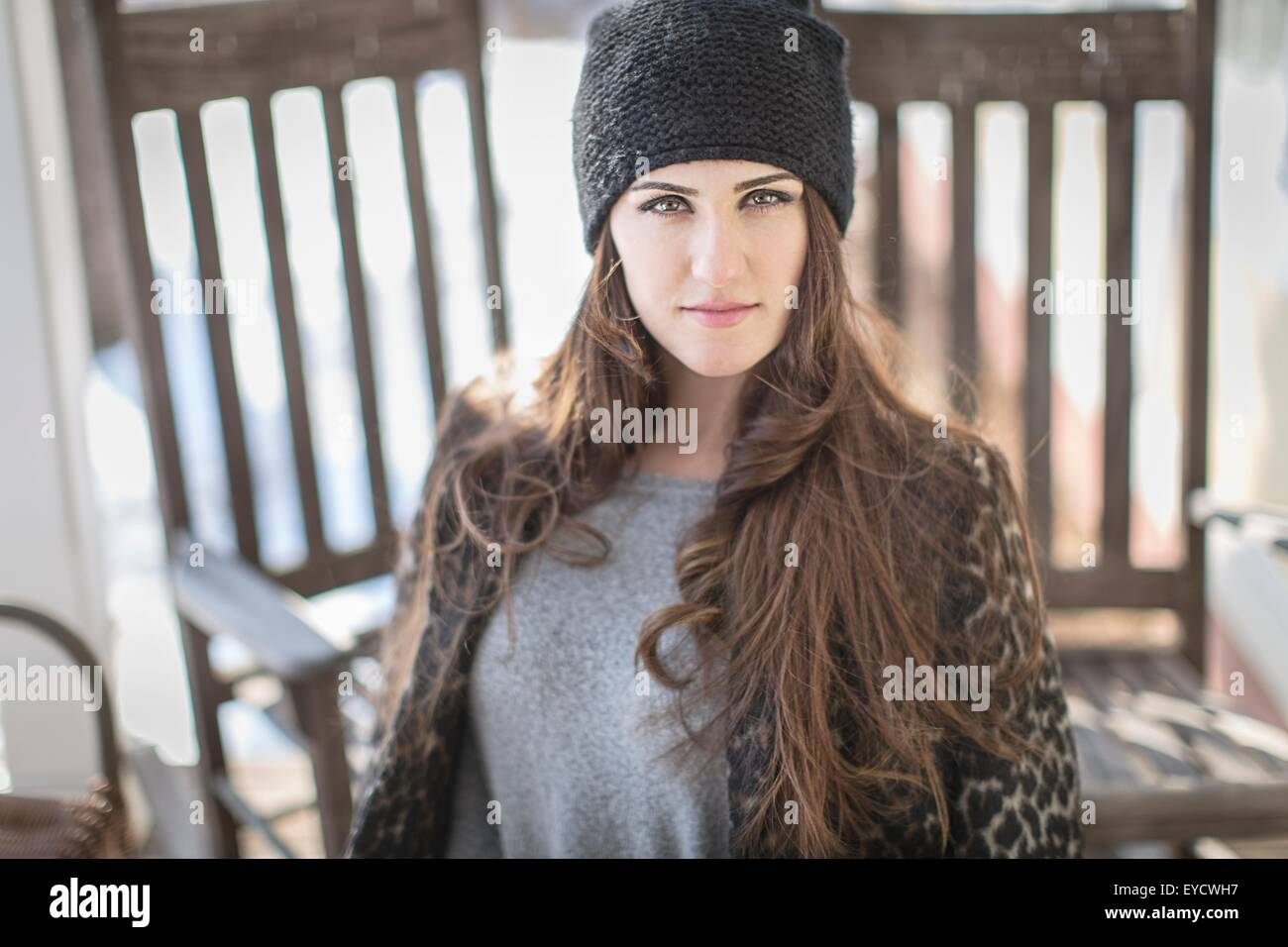 Portrait of young woman wearing knit hat - Stock Image