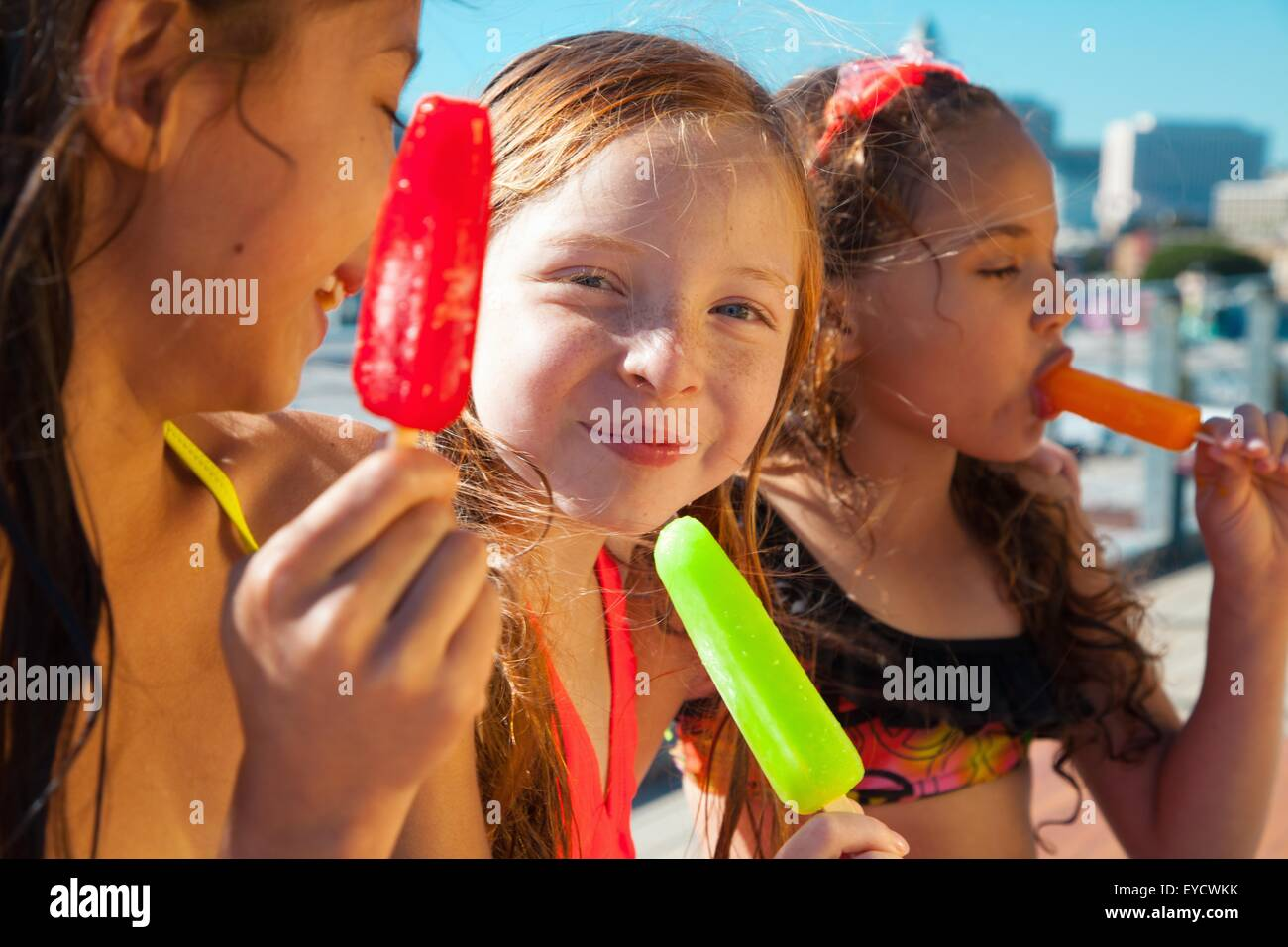 Girls eating ice lollies Stock Photo