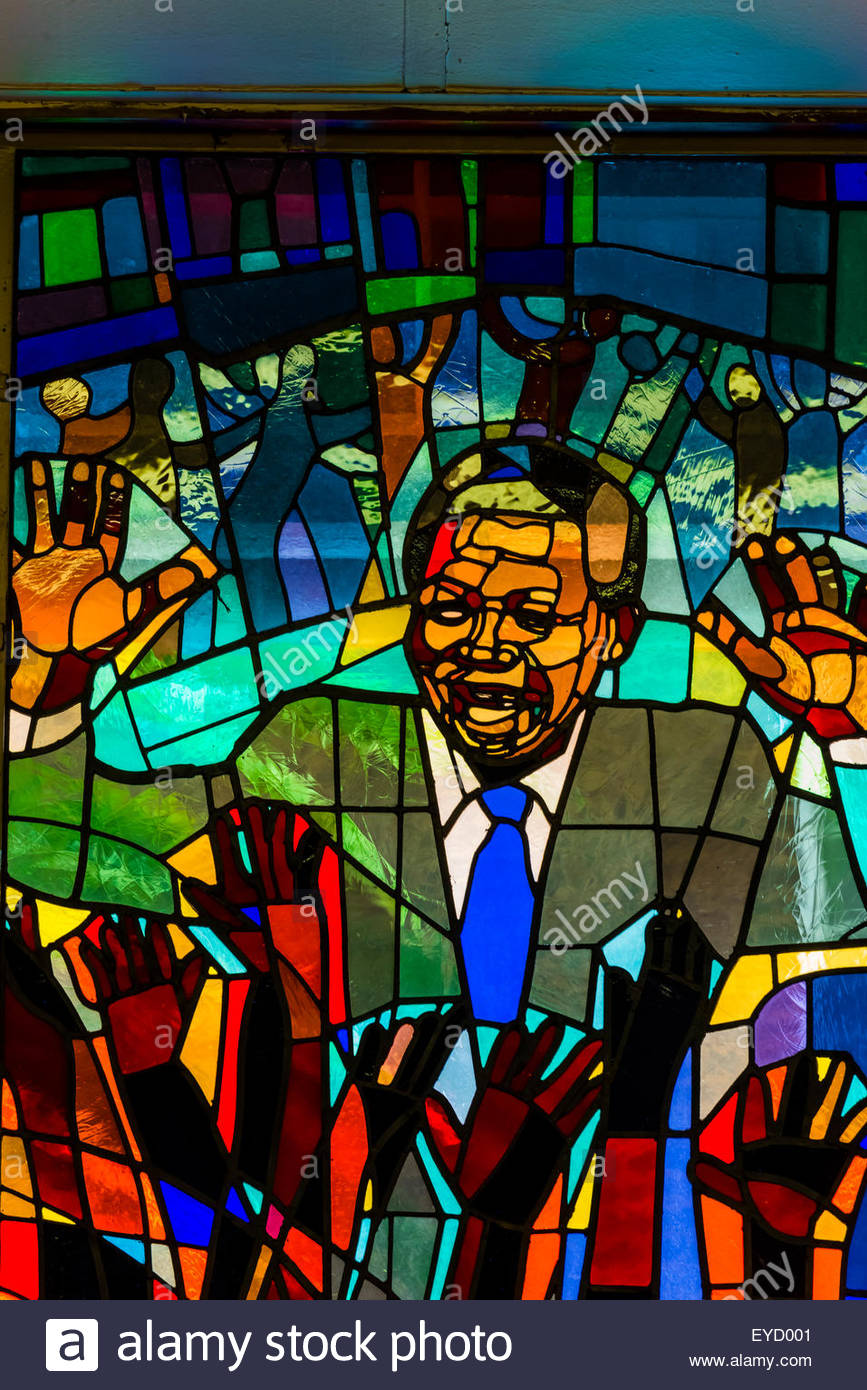 Nelson Mandela stained glass window at Regina Mundi Church, Soweto, Johannesburg, South Africa. It is the largest Stock Photo