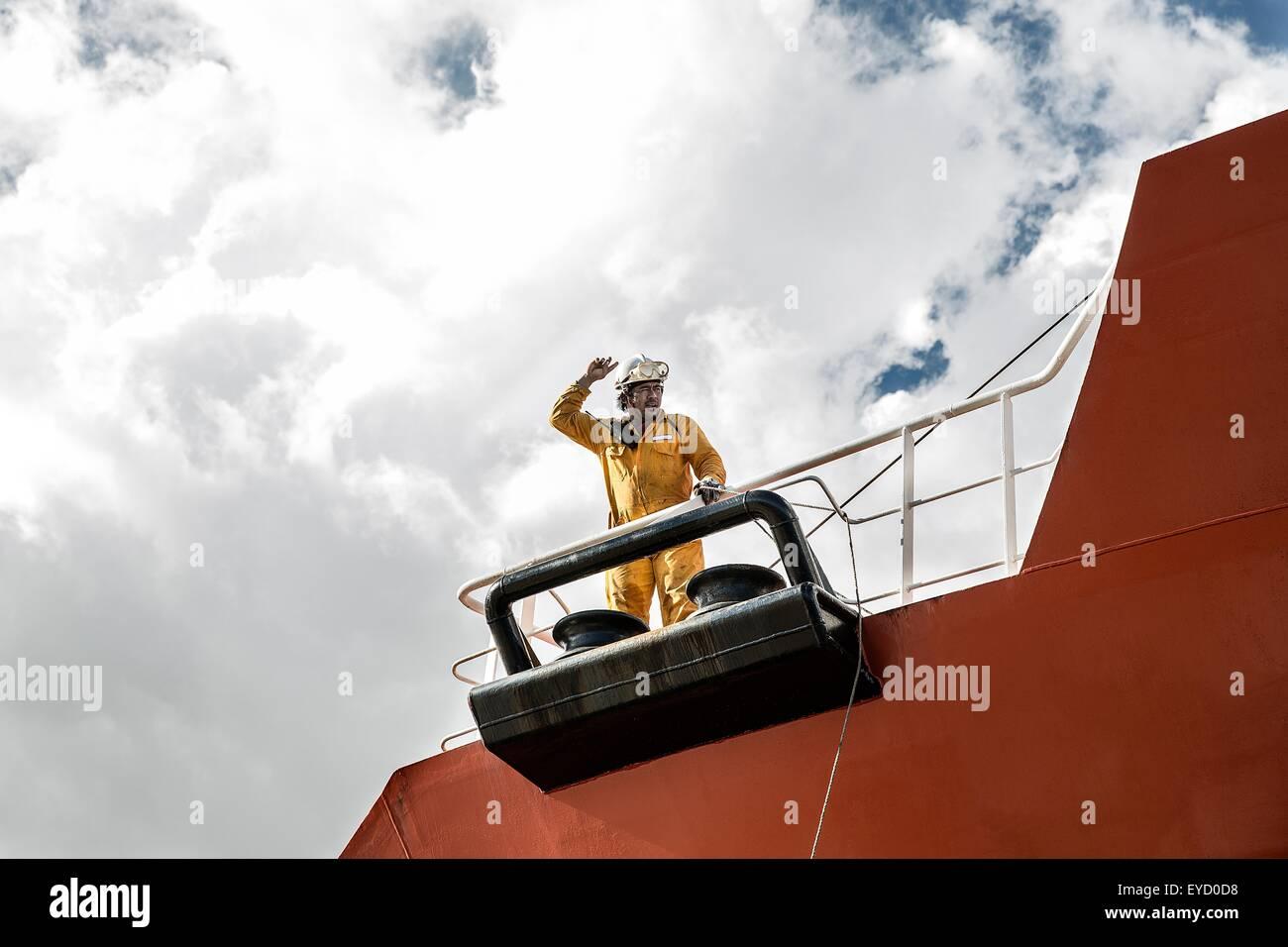 Worker mooring oil tanker on deck making hand gesture Stock Photo