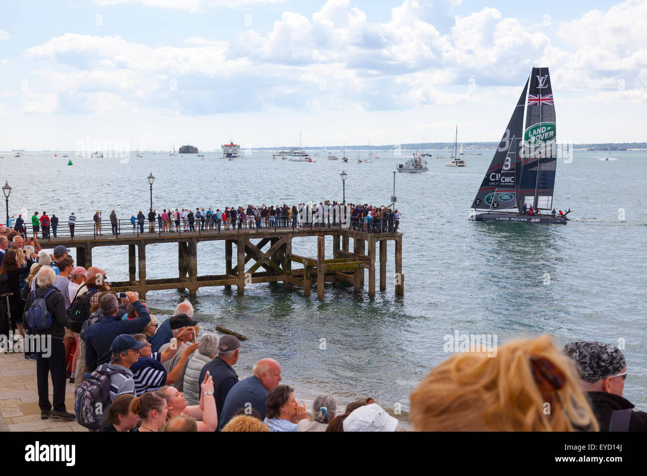 Admirals Cup races off Portsmouth on Saturday 25 July 2015 The UK Land Rover BAR  yacht salutes the gathered crowds - Stock Image