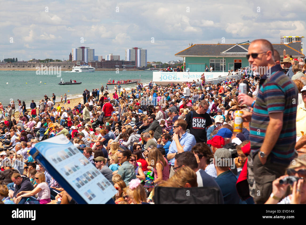 Crowds of people fill the beach to watch the Admirals Cup races off Portsmouth on Saturday 25 July 2015 Crowds gather - Stock Image