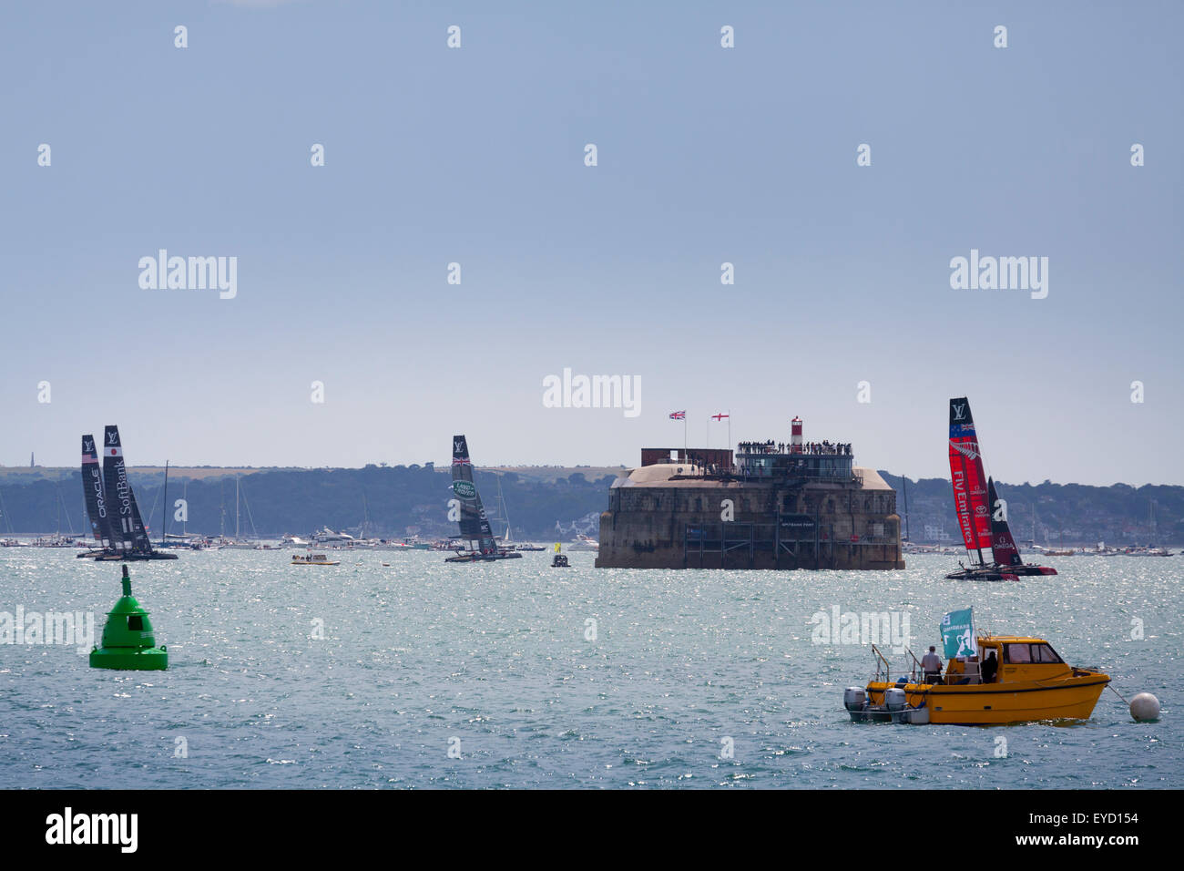 Admirals Cup races off Portsmouth on Saturday 25 July 2015 the yachts race past Spitbank Fort in the Solent - Stock Image