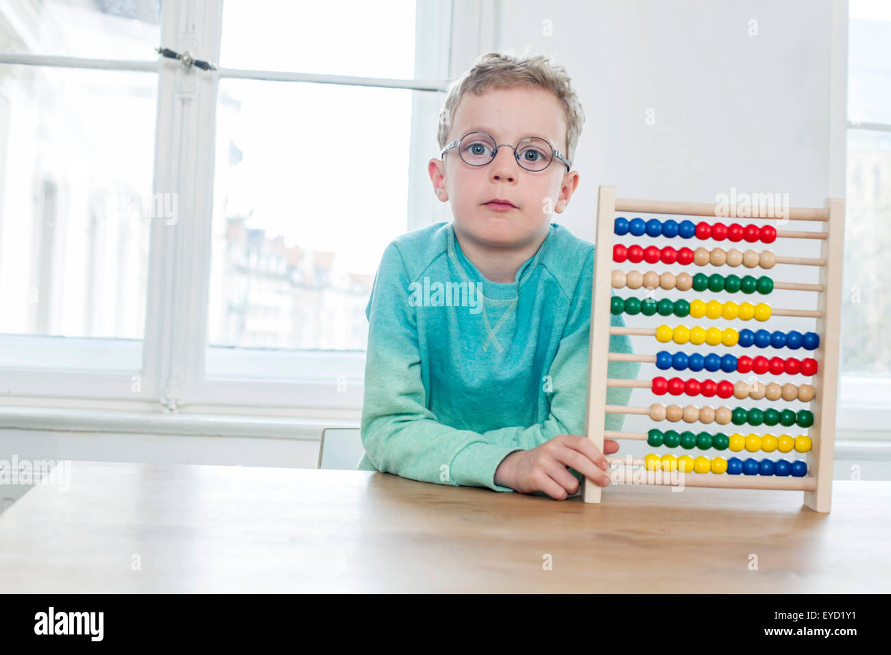 Boy calculating with abacus - Stock Image