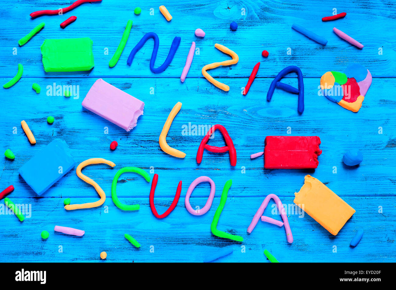 the sentence inizia la scuola, back to school in italian, written with modelling clay of different colors, on a - Stock Image