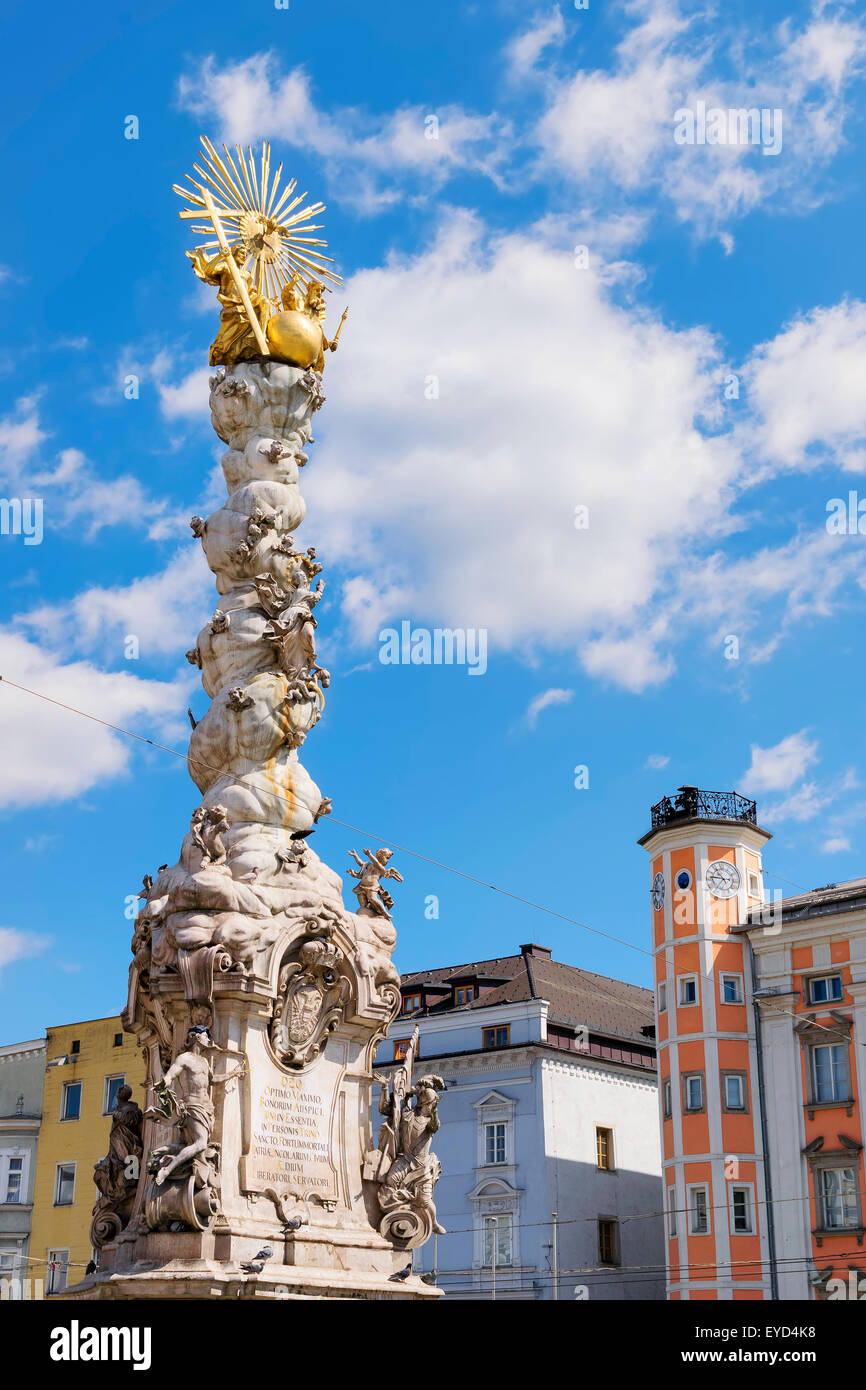 Image of the Holy Trinity Column and the town hall in the background in Linz, Austria - Stock Image