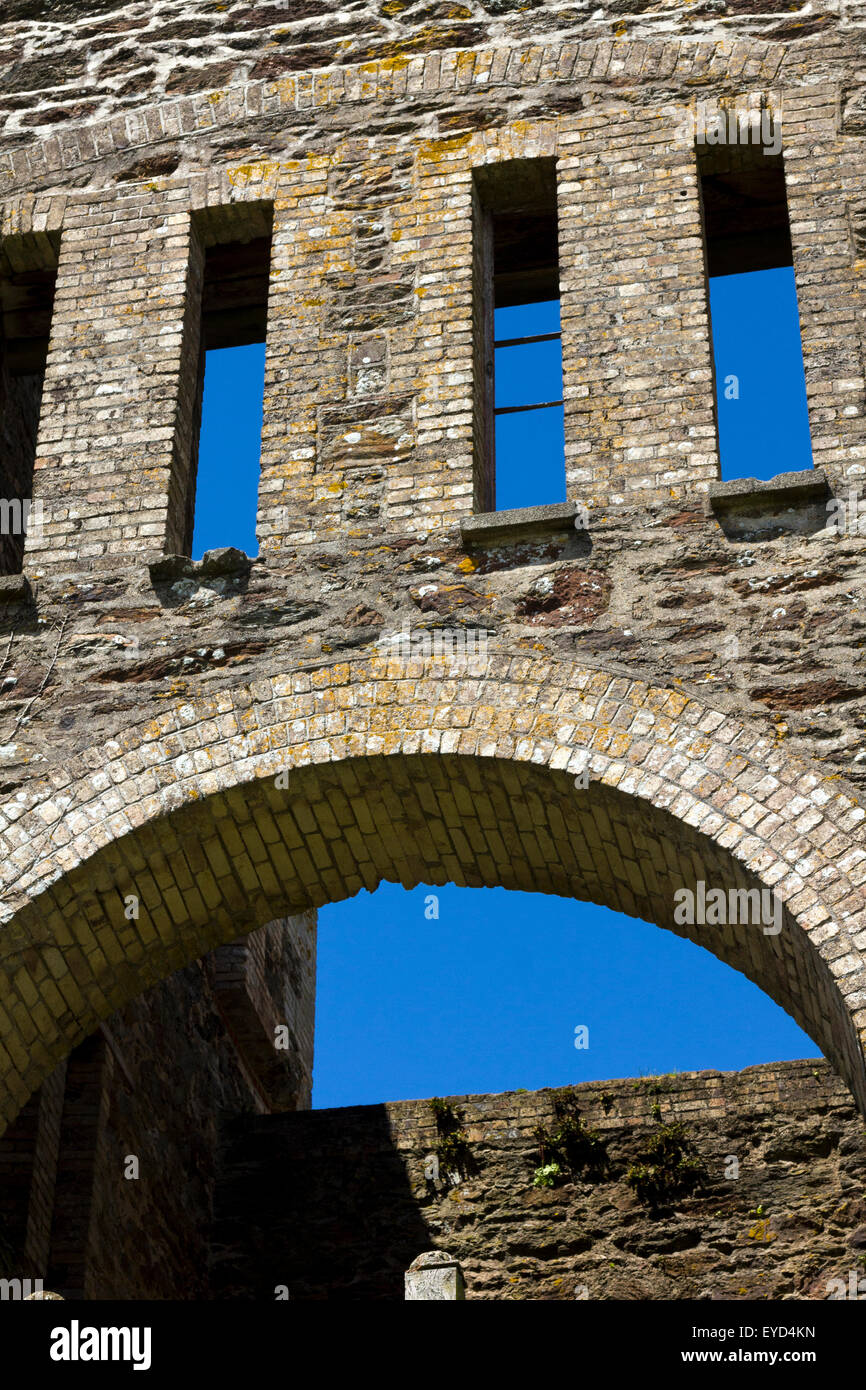 Detail of Arch and Windows on the Historic Gable End Ruins to the Engine House of Wheal Rose Tin Mine Against a - Stock Image