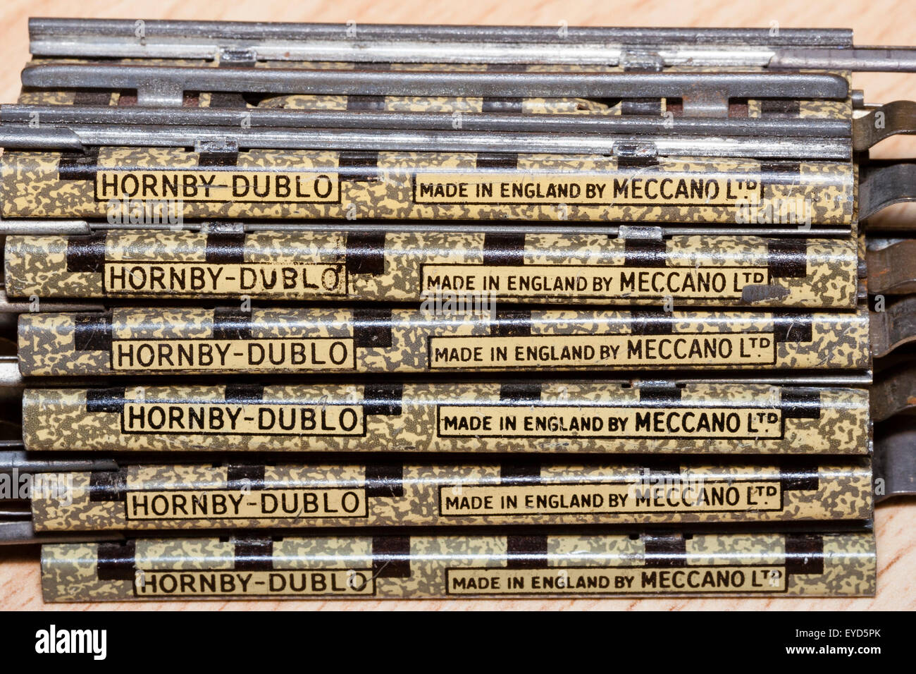 Toy train track, Hornby-Dublo, Meccano 1950's, Three rail track sections stacked on top of each other with 'made Stock Photo
