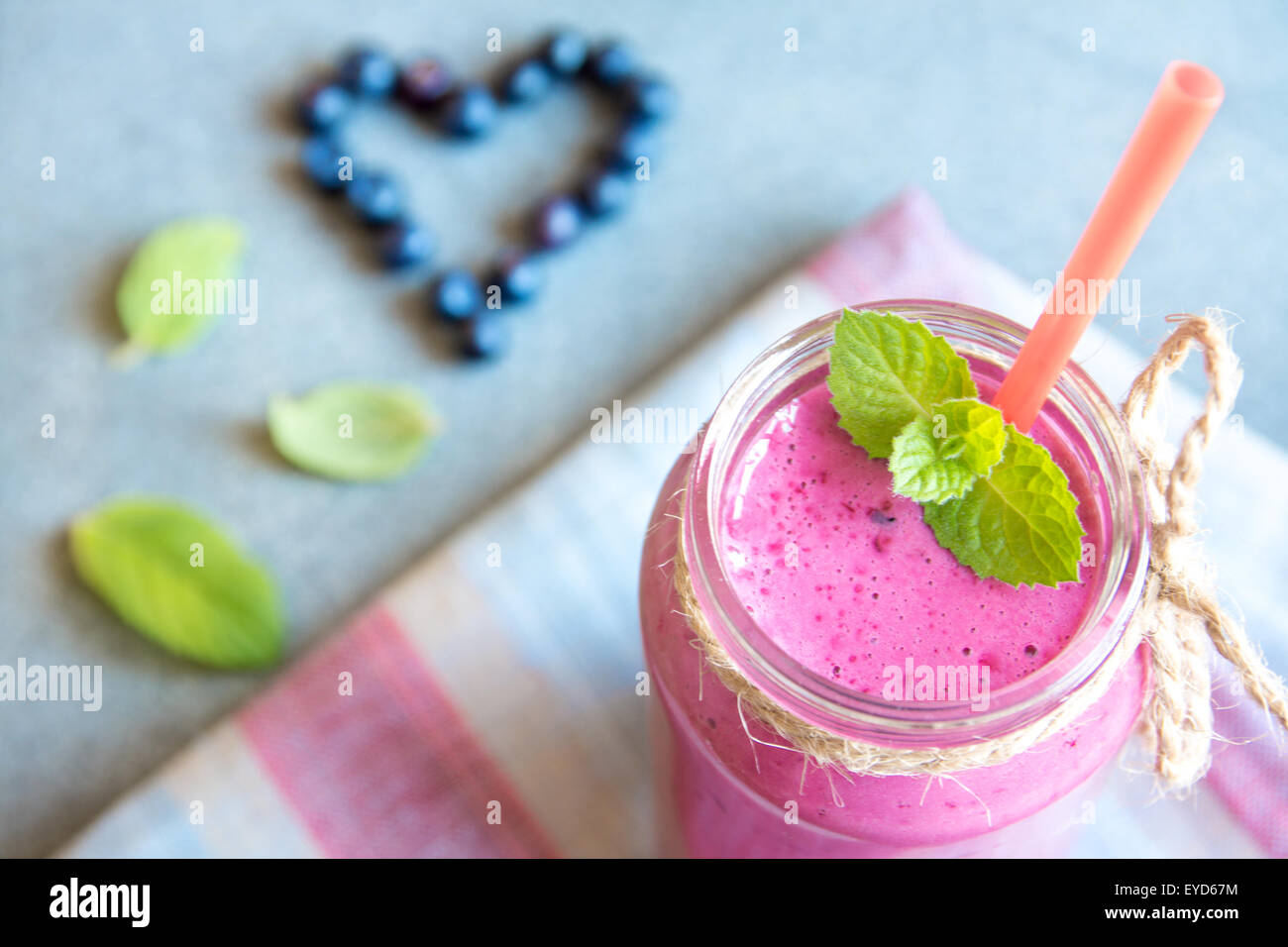Blueberry smoothie with mint and heart from berries, organic healthy raw food - Stock Image