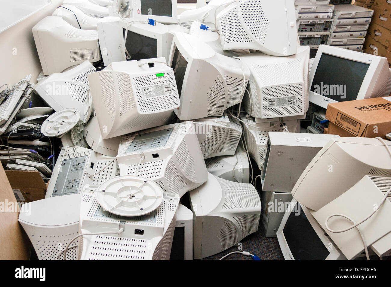 Outdated computer monitors, piled and stacked awaiting to be taken for recycling - Stock Image
