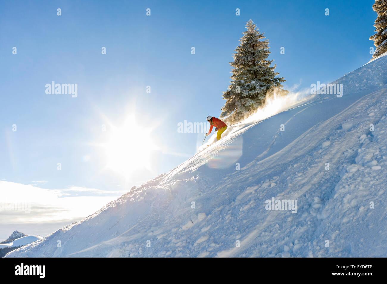 Ski holiday, Woman skiing downhill, Sudelfeld, Bavaria, Germany - Stock Image