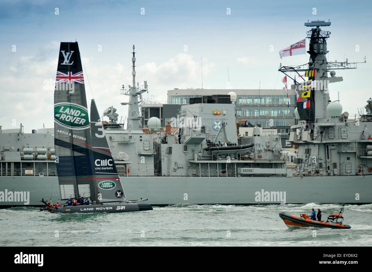 America's Cup World Series Portsmouth. Sir Ben Ainslie passing HMS St Albans - Stock Image