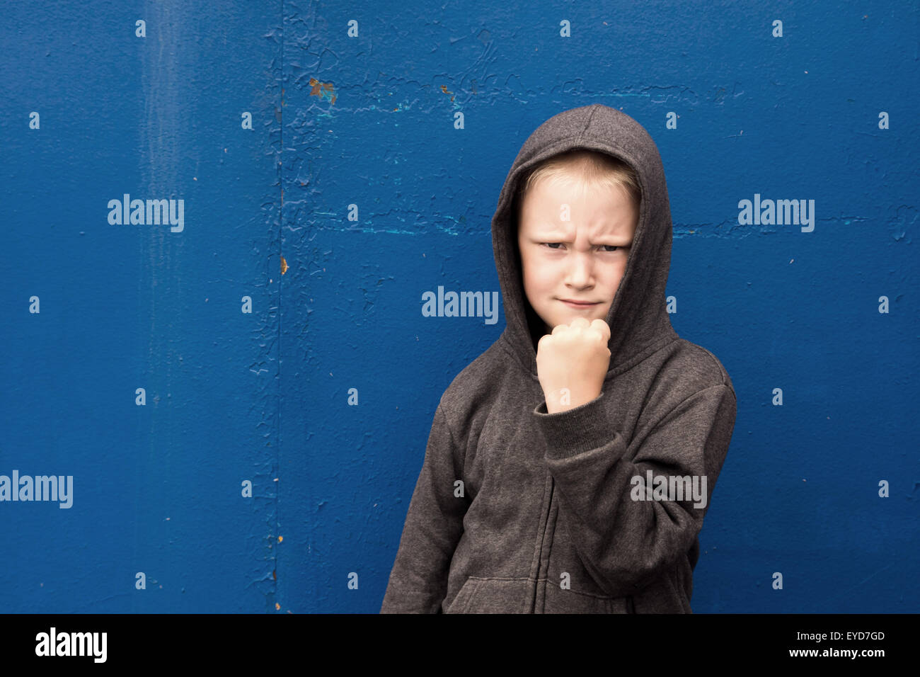 angry aggressive boy (child) shows his fist, threatening - Stock Image