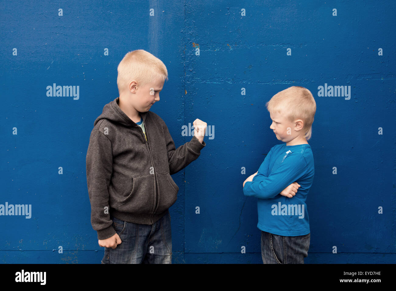 fight between two brothers (kids, boys), angry aggressive children - Stock Image