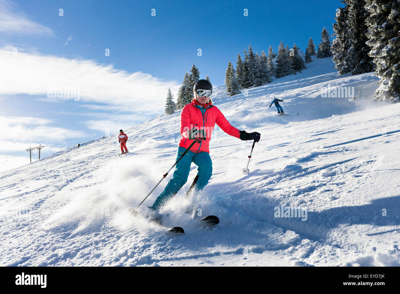 Ski holiday, Group of skiers carving downhill, Sudelfeld, Bavaria, Germany - Stock Image