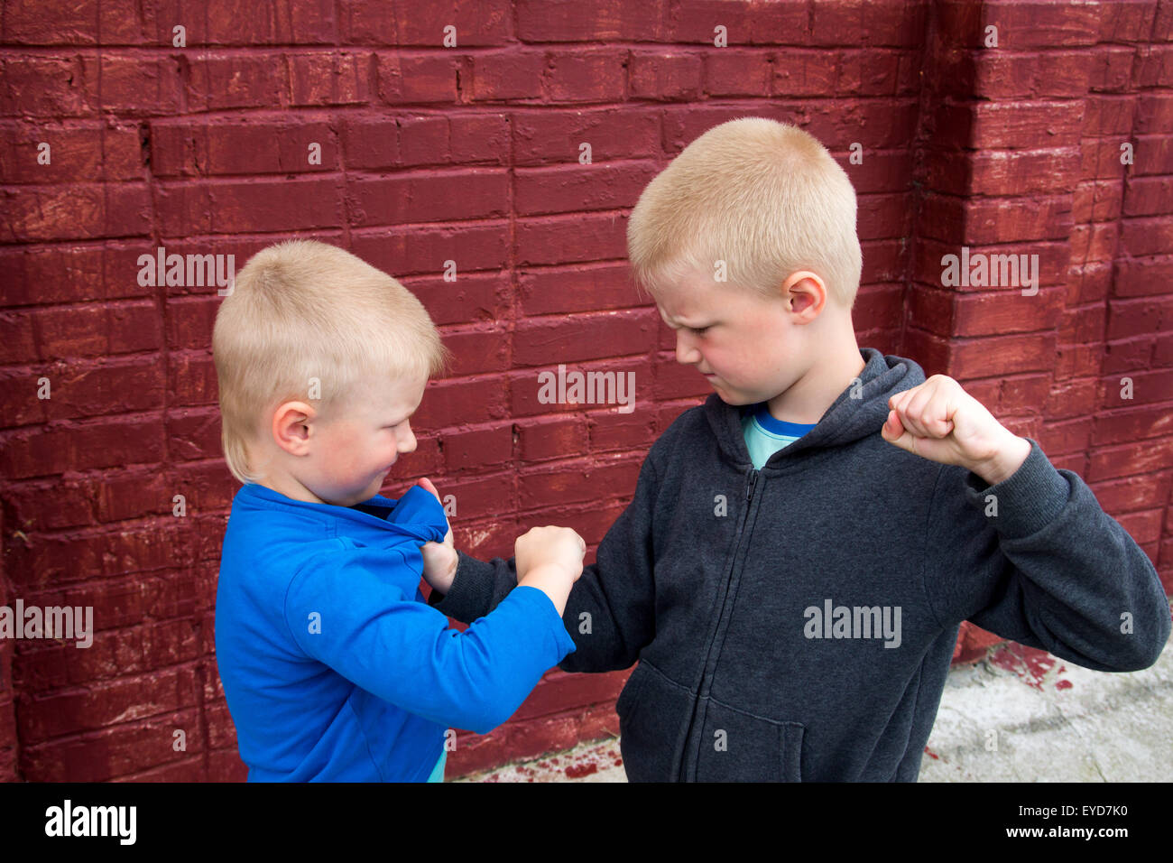 children fight between two angry aggressive brothers (kids, boys) - Stock Image