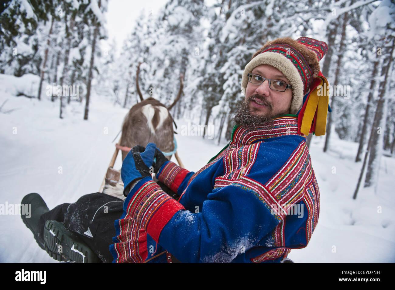 1bca347b3ee A Herder With Reindeer Wearing The Traditional Sami Clothing At  Ounaskievari Reindeer Farm