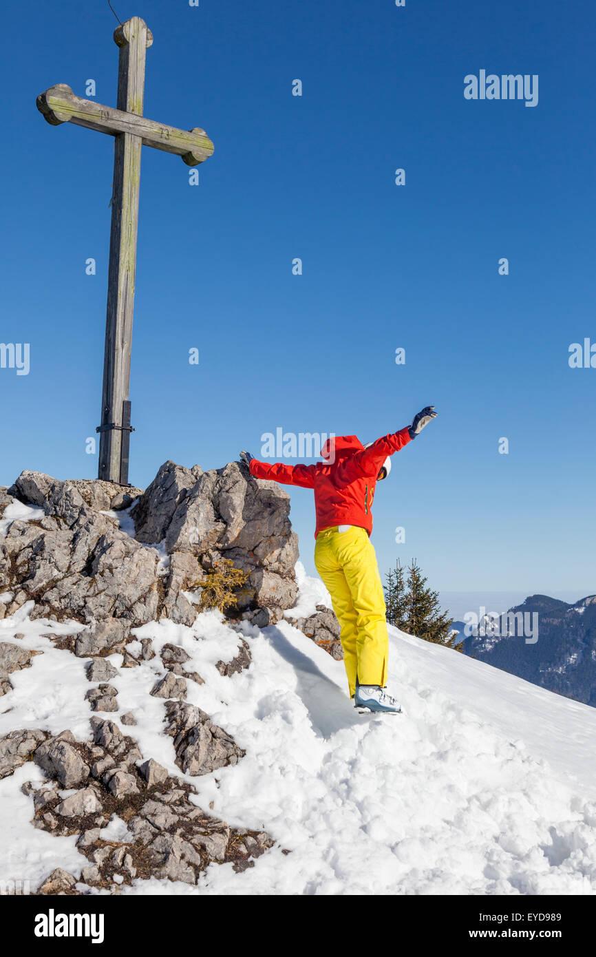 Ski holiday, Happy skier jumping on mountain peak, Sudelfeld, Bavaria, Germany - Stock Image