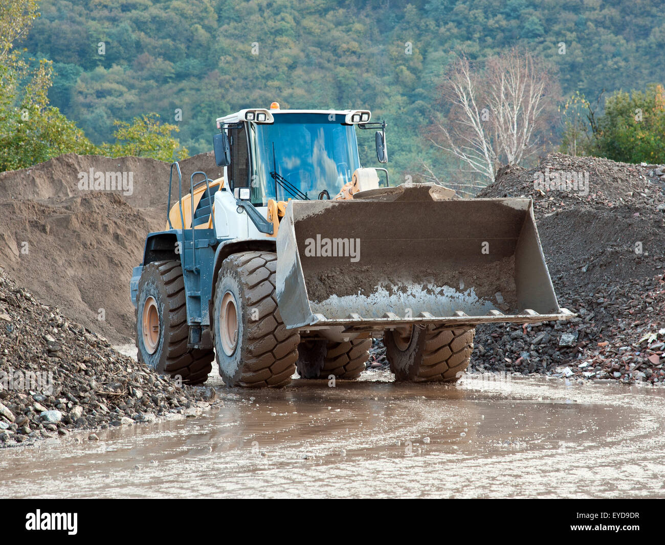 Digger to work in a quarry - Stock Image