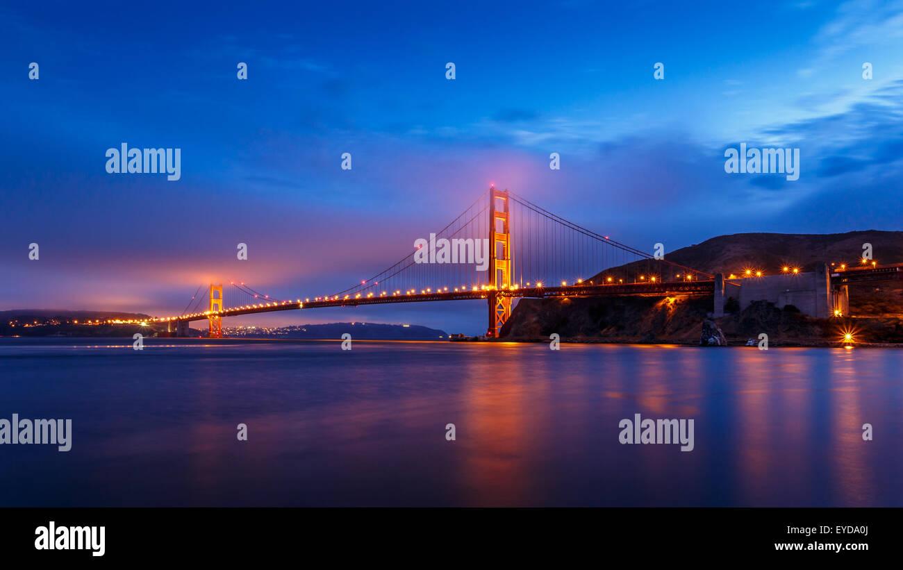 San Francisco Golden Gate Bridge illuminated at night in California, USA - Stock Image