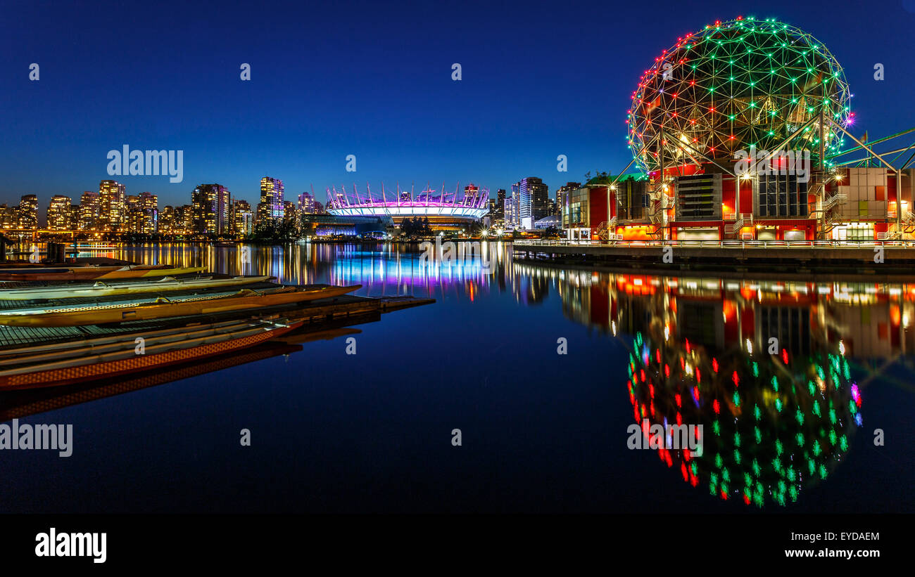 Science World and BC Olympic Place illuminated at night in Vancouver, Canada - Stock Image