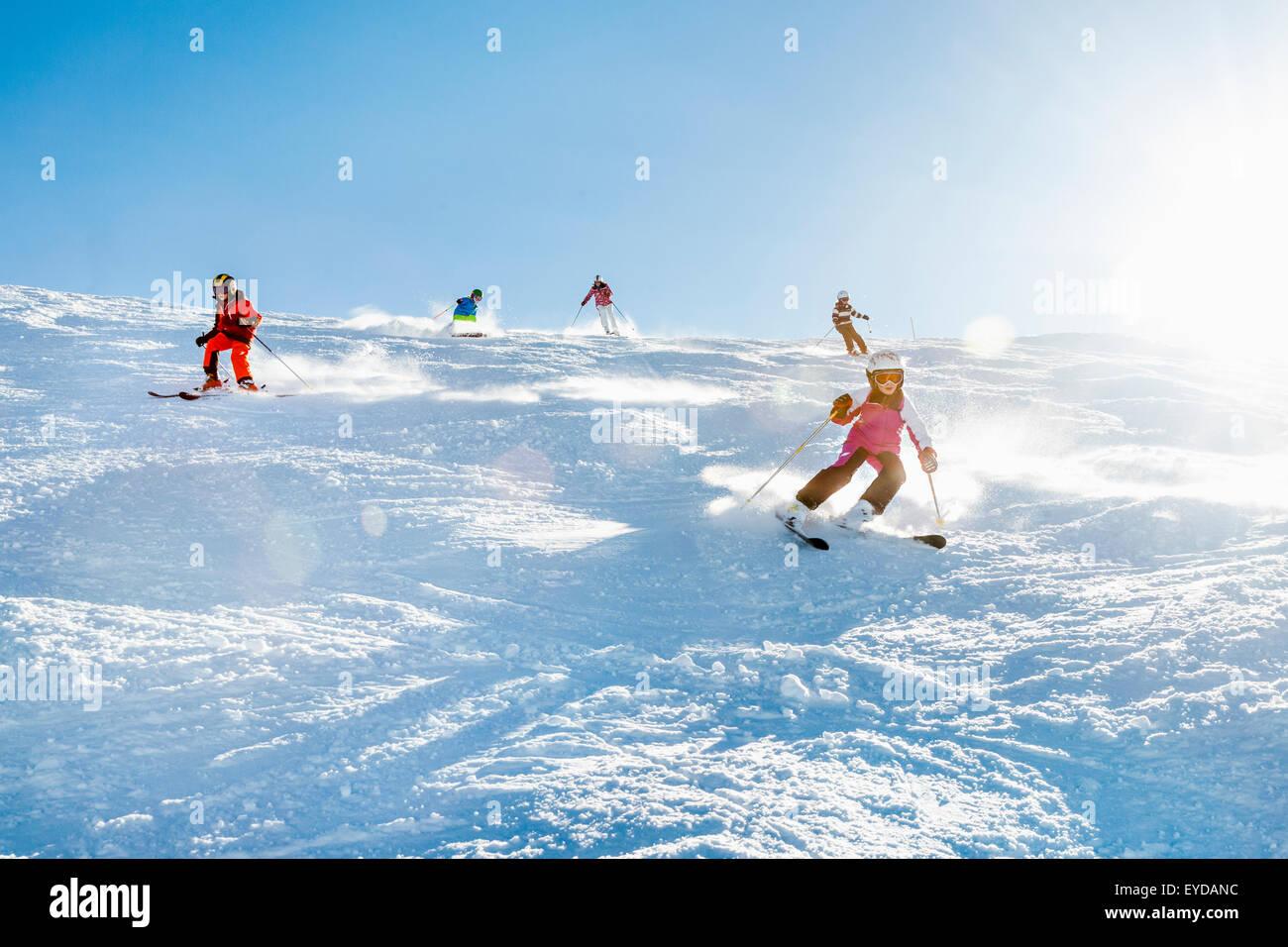 Ski holiday, Children carving downhill, Sudelfeld, Bavaria, Germany - Stock Image