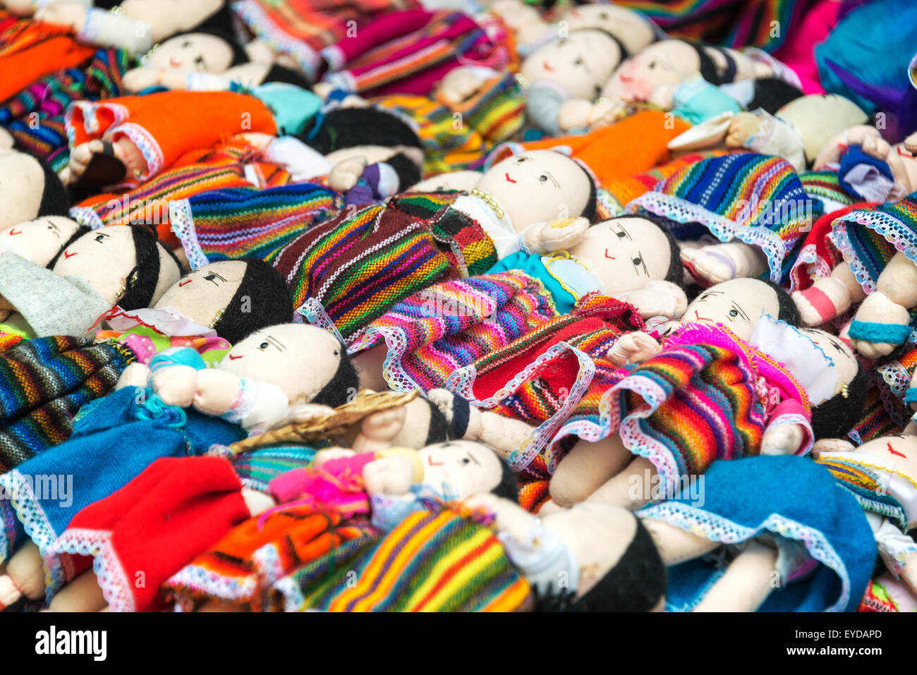 Souvenir dolls for sale in traditional clothing in Otavalo, Ecuador - Stock Image