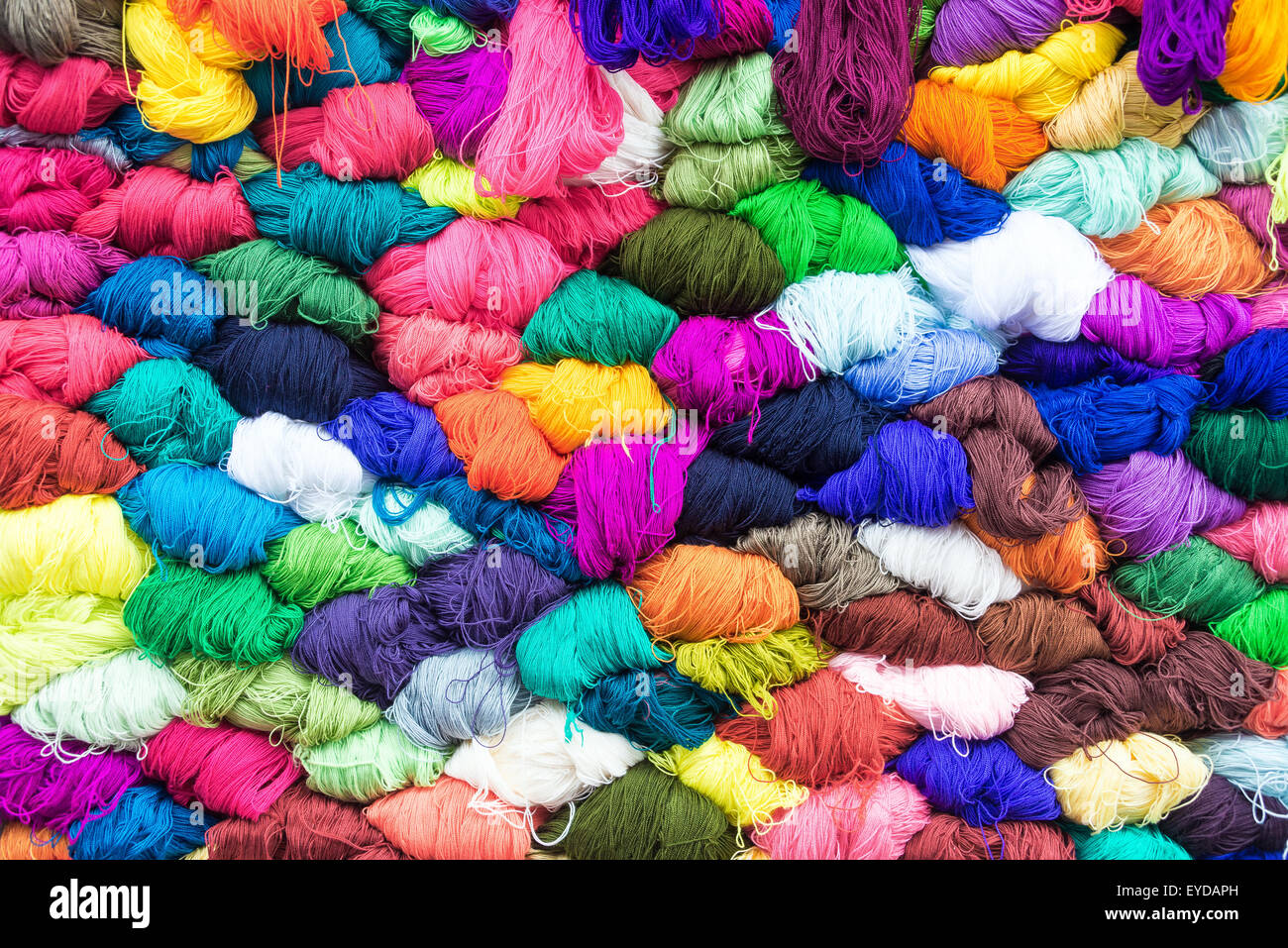 Colorful yarn for sale in the famous market in Otavalo, Ecuador - Stock Image