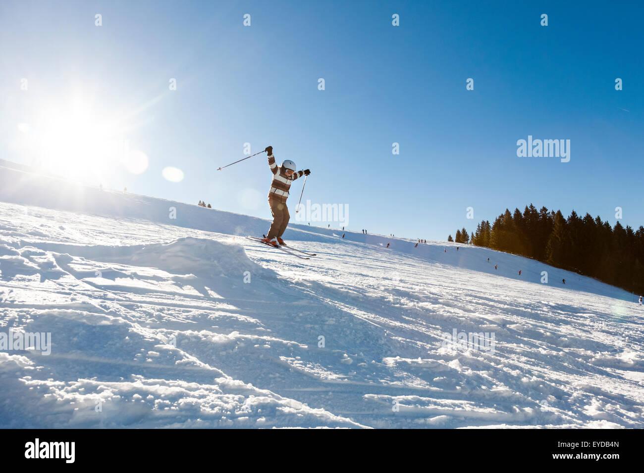 Ski holiday, Boy skiing downhill, Sudelfeld, Bavaria, Germany - Stock Image