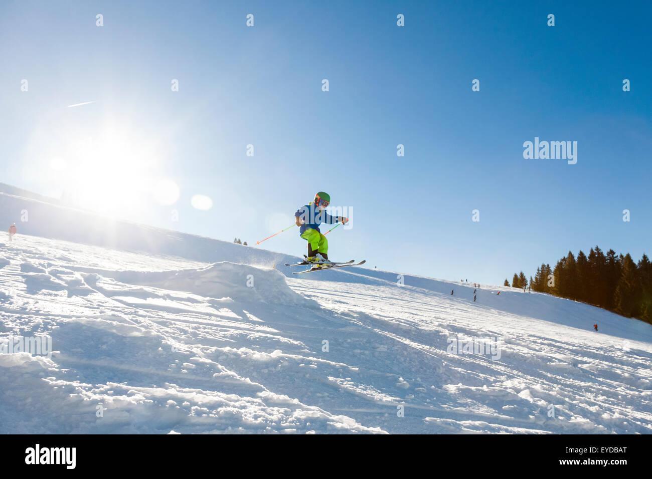 Ski holiday, Child skiing downhill, Sudelfeld, Bavaria, Germany - Stock Image