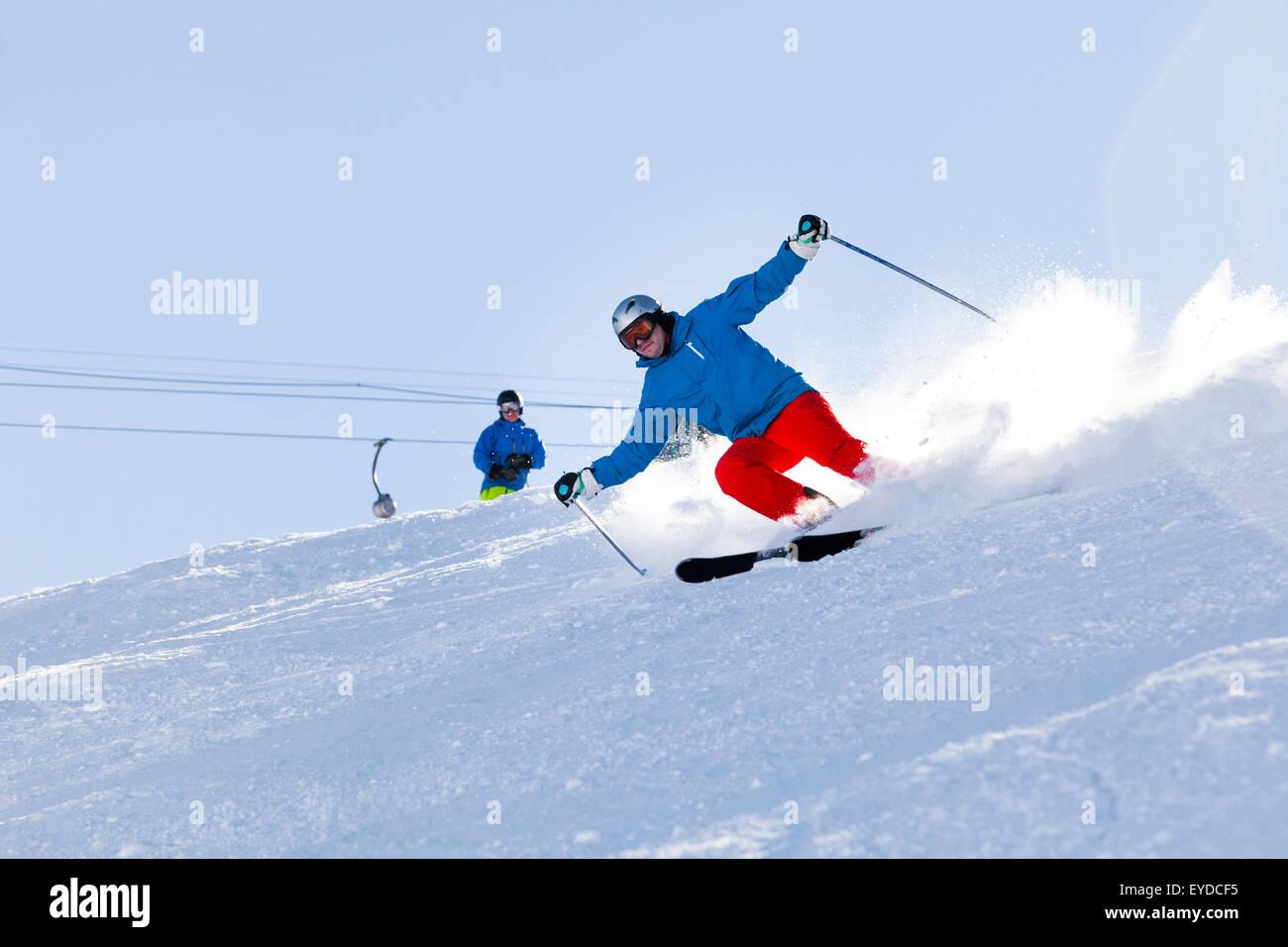 Ski holiday, Skier carving downhill, Sudelfeld, Bavaria, Germany Stock Photo