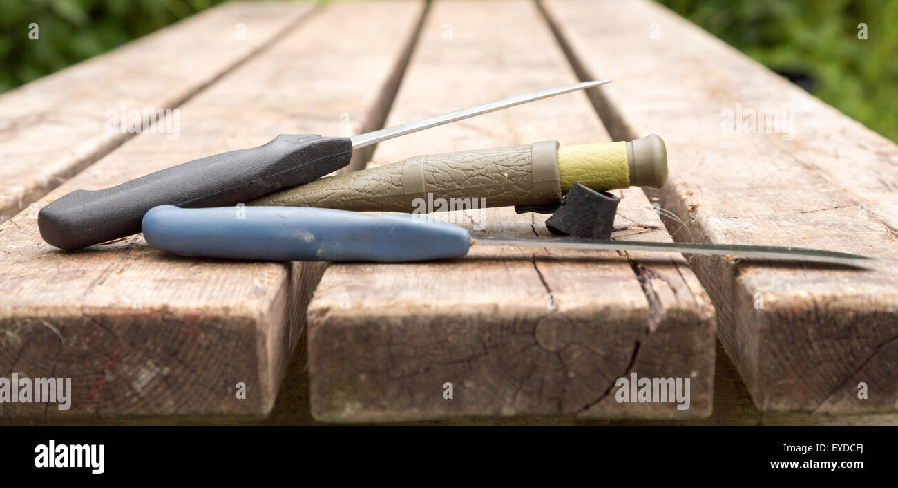 Thrre Knifes Lying on Table - Stock Image