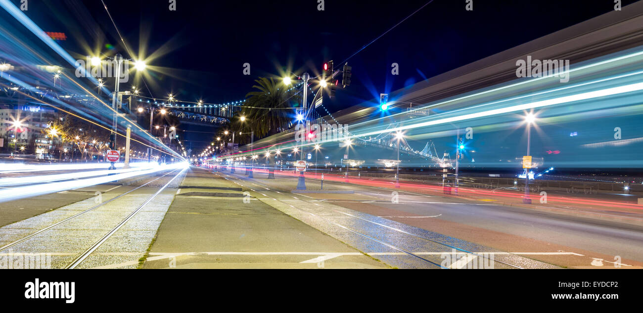 Light trail motion blur of traffic in the city at night - Stock Image