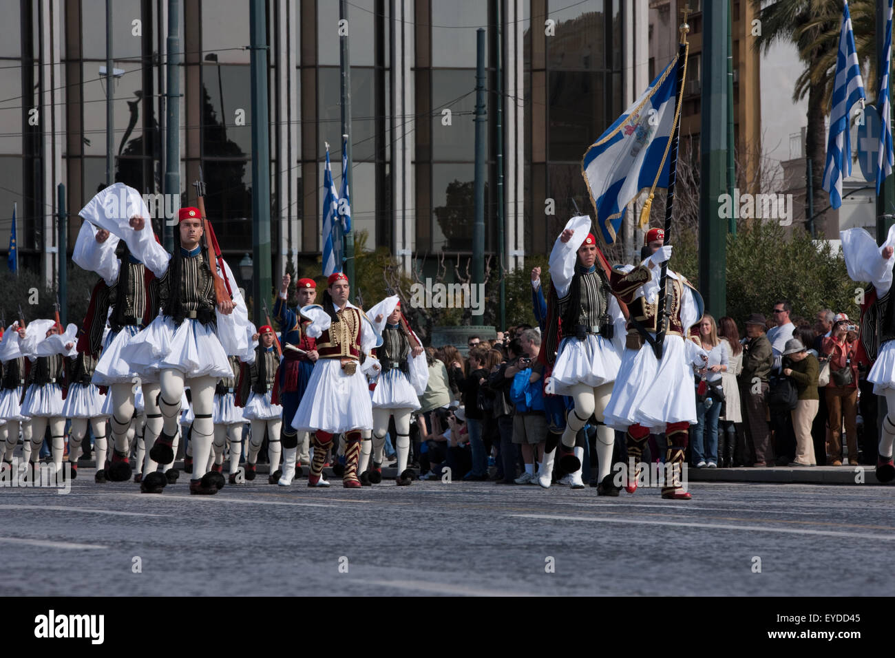 Greek guards (Tsoliades) regiment march outside Greek Parliament in Syntagma sq., to attend a ceremonial event. - Stock Image