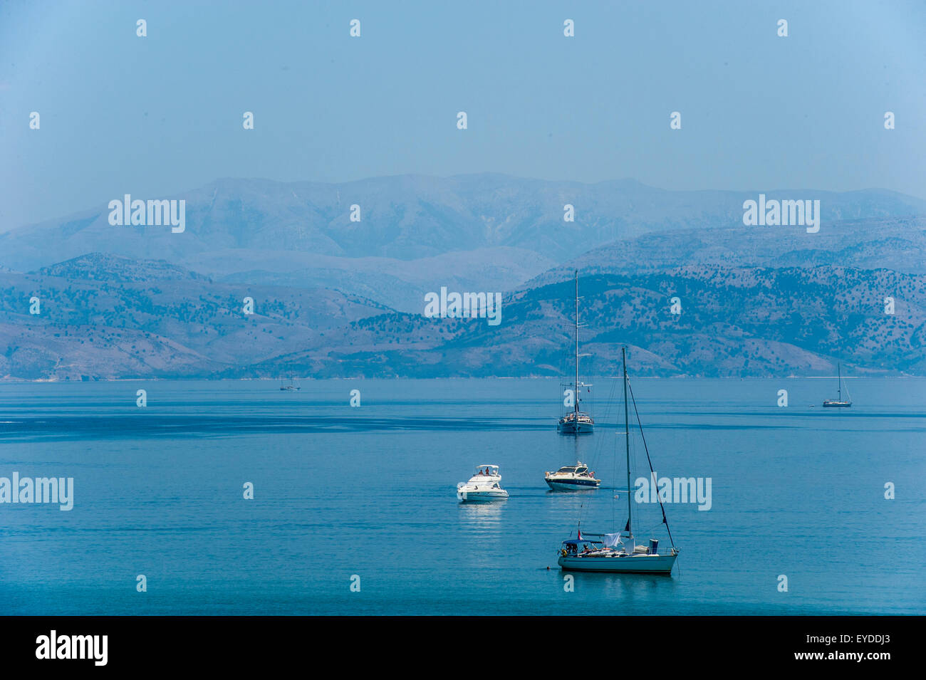 Sailing boats in the Ionian sea just outside Corfu town with Albania in the distance - Stock Image