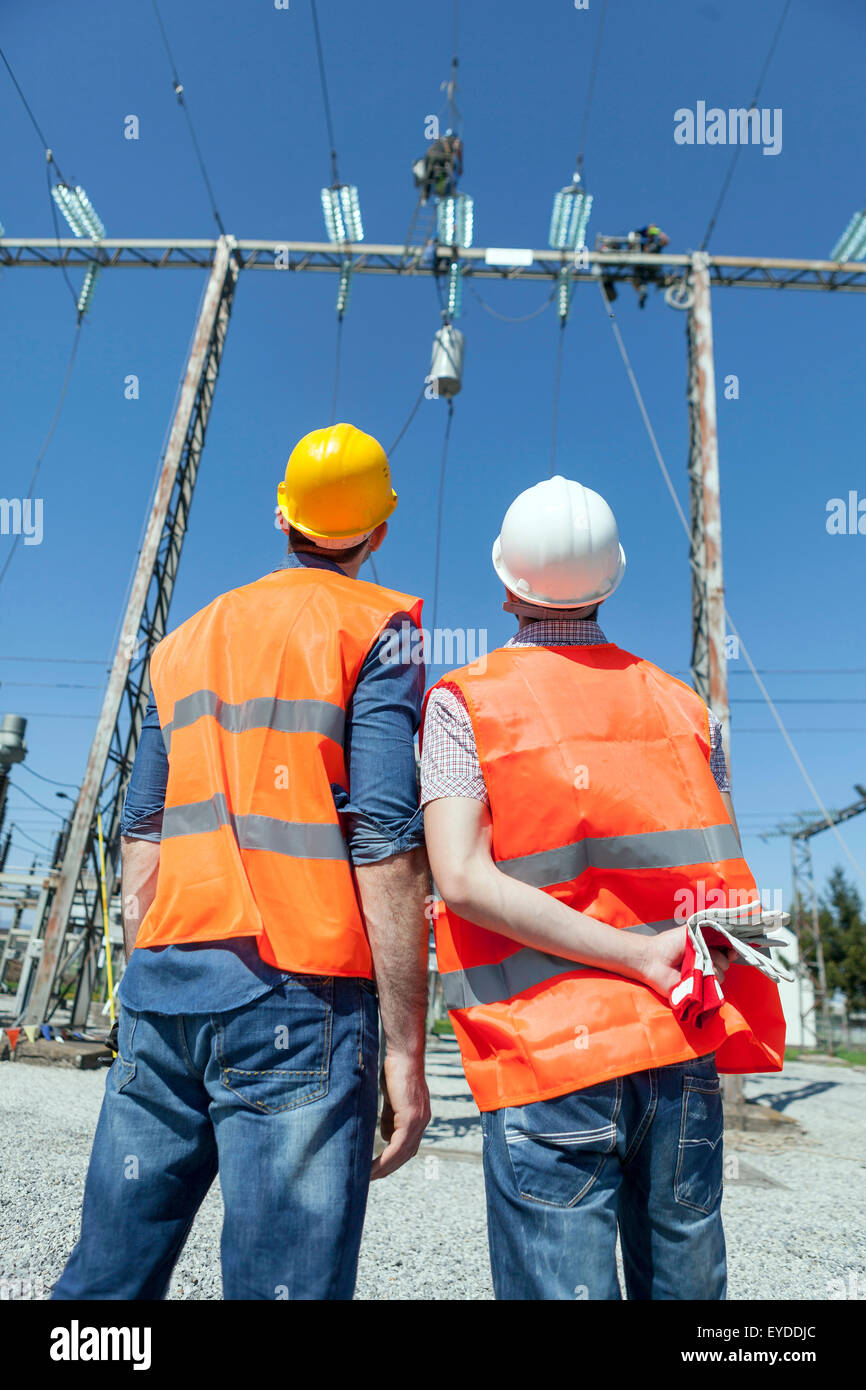 Two engineers checking electricity substation - Stock Image
