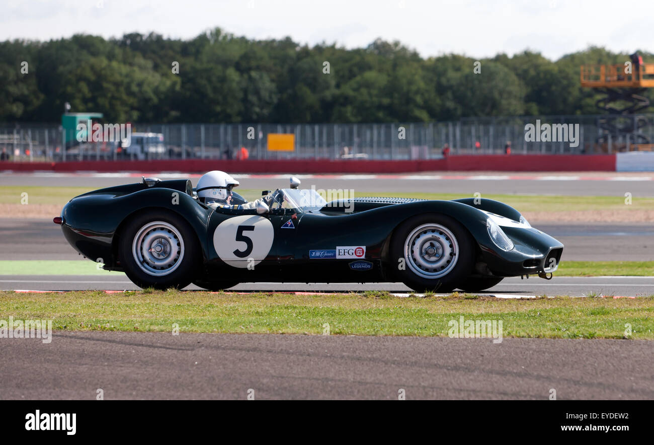 John Pearson driving a  Lister Jaguar Knobbly, in the Stirling Moss Trophy for pre' 61 Sports Cars at the Silverstone - Stock Image