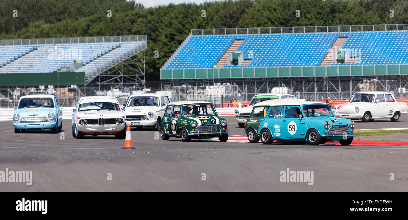 Action picture of the Warwick Banks Trophy race for under 2 litre 1960's touring cars, held during the Silverstone - Stock Image