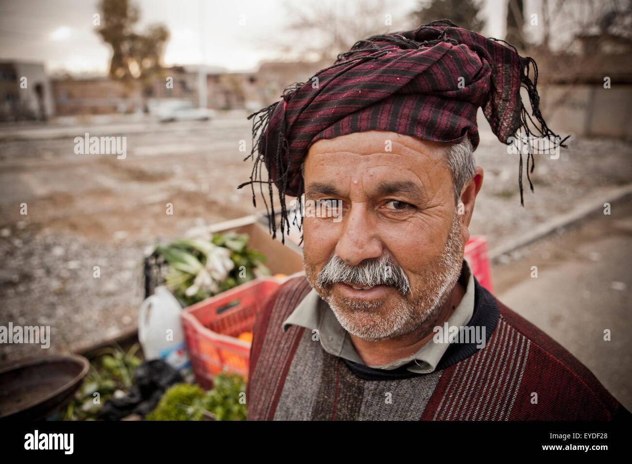 Portrait Of A Kurdish Street Vendor, Sulaymaniyah, Iraqi Kurdistan, Iraq - Stock Image