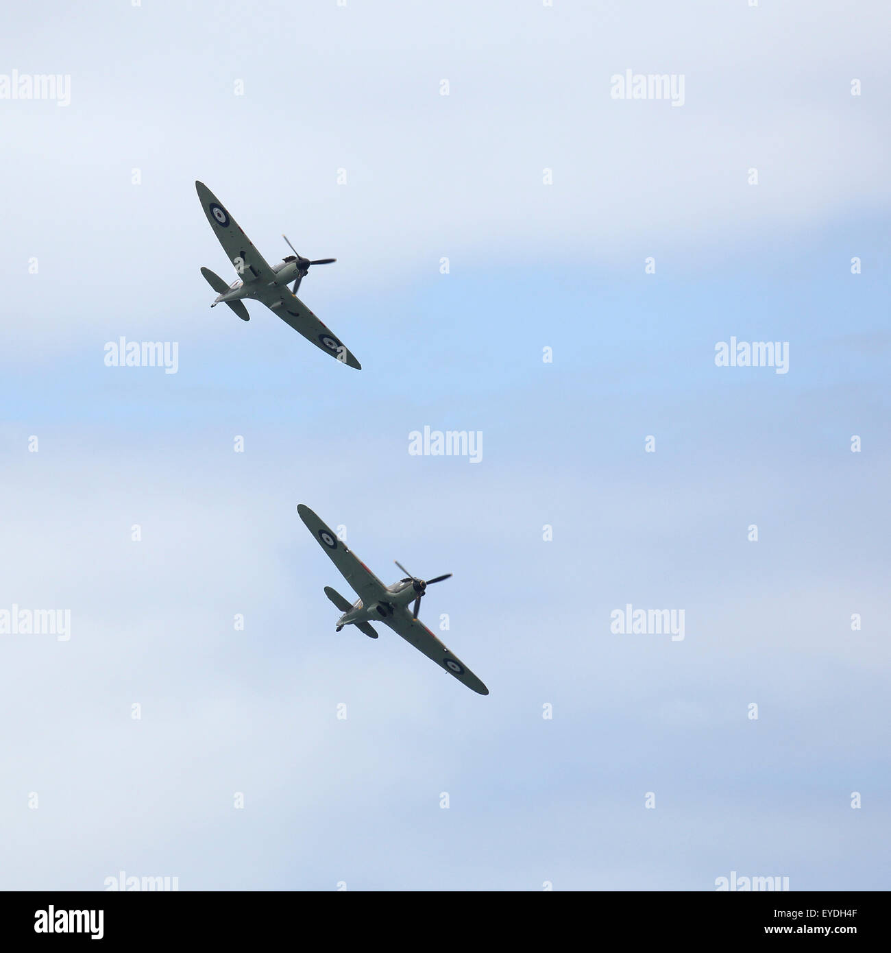 A Spitfire and a Hurricane, fighter aircraft from World War Two, perform at Sunderland International Airshow. - Stock Image