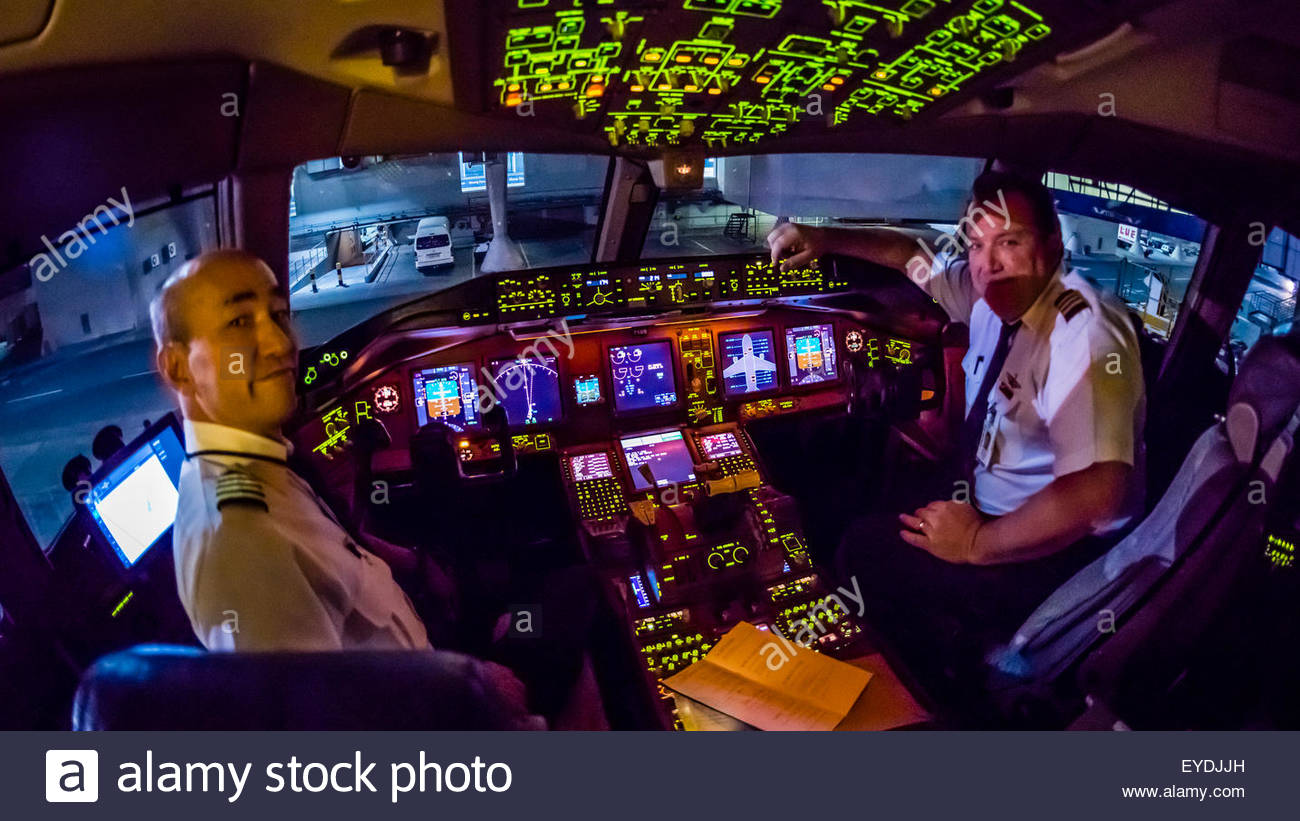 Pilots in the cockpit prepare the Delta Airlines Boeing 777-200LR  for the 17 hour flight from Atlanta, Georgia - Stock Image