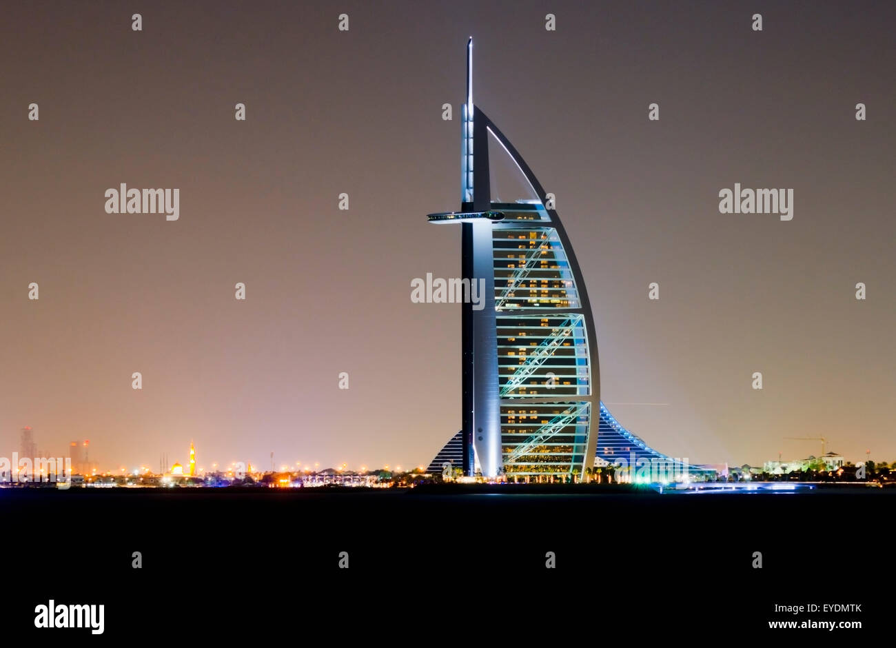 United Arab Emirates, View of Burj al Arab Hotel at dusk; Dubai - Stock Image