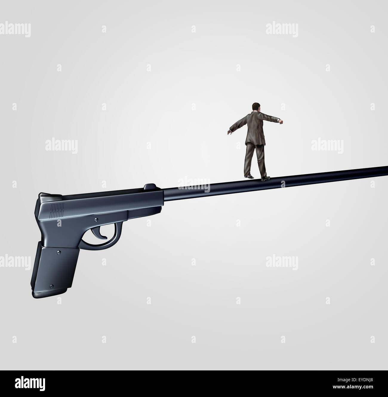 Gun risk concept and firearm social issue symbol as a person walking on the long barrel of a pistol as a highwire - Stock Image