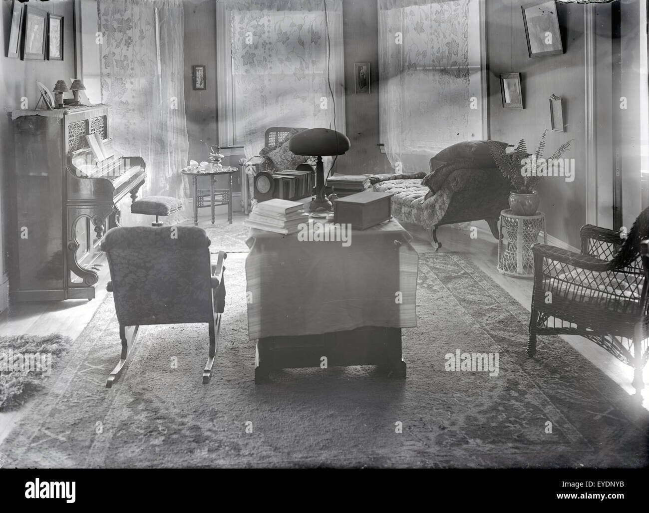 Antique c1910 photograph of a late Victorian, circa 1910s parlor with upright piano and furnishings. See Alamy image - Stock Image